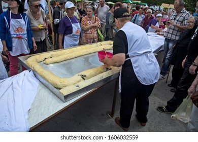 Zrenjanin, Serbia, May 27, 2017. Contest of women at ethno festival in making big cake. A large, huge poppy strudel is being prepared.