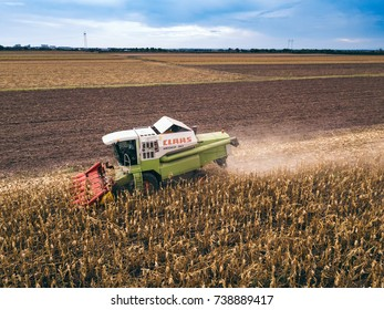 ZRENJANIN, SERBIA - SEPTEMBER 19, 2017: Aerial view of Claas combine harvester working on corn field. Lower maize crop yield expected this year in Vojvodina region due to drought during summer.