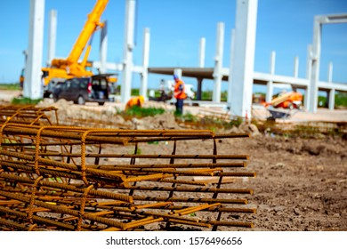 Zrenjanin, Vojvodina, Serbia - April 20, 2018: View on rusty square reinforcement for concrete, construction site is in background.