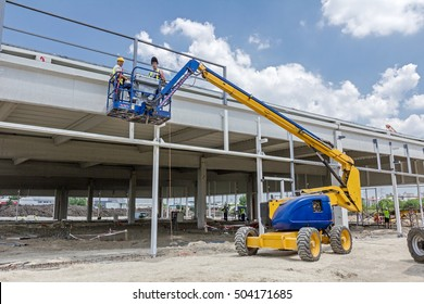 Zrenjanin, Vojvodina, Serbia - June 4, 2015: High elevated cherry picker with team of workers on construction site.