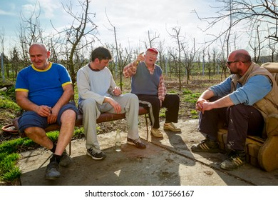 Zrenjanin, Vojvodina, Serbia - March 20, 2017: People are sitting and having casual talk, senior is talking.