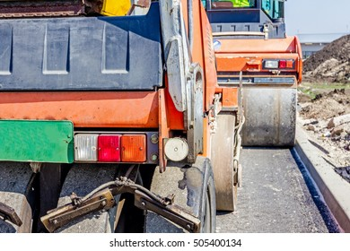 Zrenjanin, Vojvodina, Serbia - September 23, 2015: Group of machines for spreading asphalt are parked after road construction at building site.