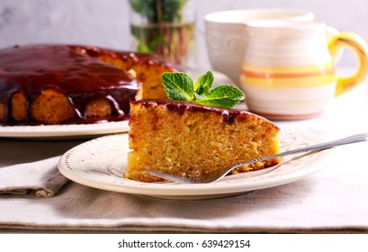 Zucchini and carrot cake with chocolate glaze, on plate