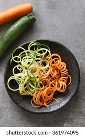 Zucchini and carrot noodles on a plate.Top view.