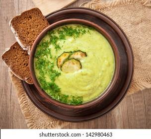zucchini cream soup in a ceramic bowl