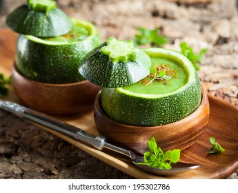 Zucchini cream soup served in a round zucchini