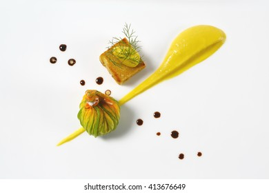 zucchini flower stuffed with mozzarella cube with chickpeas and lemon cream