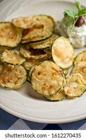 Zucchini fried. Farm fresh organic zucchini, thinly sliced  and dipped in egg and milk then dredged in seasoned flour and fried in oil in cast iron skillet. Traditional Greek or Italian favorite