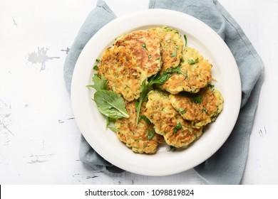 Zucchini fritters. Vegetable vegetarian zucchini pancakes