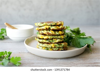 Zucchini fritters or vegetarian zucchini pancakes with yogurt sauce. Vegetarian food