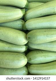 zucchini harvest. zucchini for food background. many green zucchini at Ukrainian market.