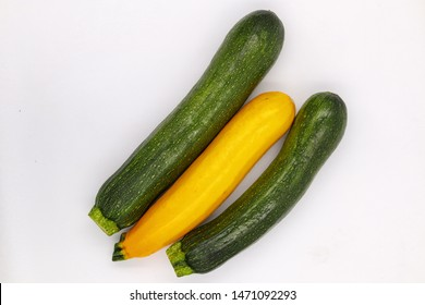 Zucchini Isolated on White Background. Fresh Organic Vegetarian Courgette Plant. Marrow Squash Raw Agriculture Food. Yellow and Green Ugly Organic Veggies Closeup. Delicious Garden Greenery