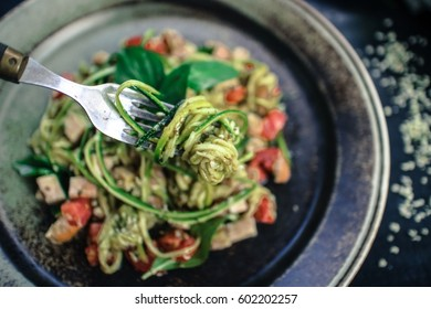 """zoodles"" zucchini noodles with basil pesto"