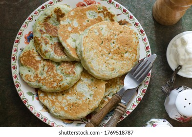 Zucchini pancakes with sour cream and dill