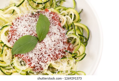 Zucchini Pasta Topped with Parmesean Cheese and Tomato Sauce