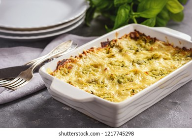 Zucchini and potatoe casserole with cheese,  vegetarian food.