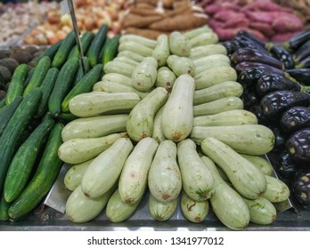 zucchini for sale in supermarket in hortifruti section, with background unfocused