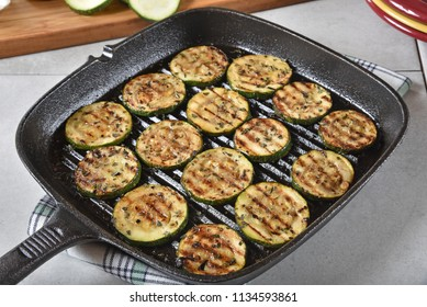 Zucchini slices fried in olive oil with basil and parmesan cheese