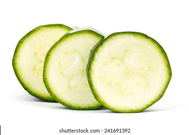 zucchini slices on white background isolated