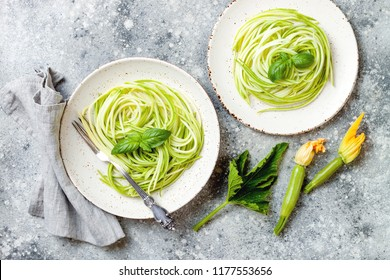 Zucchini spaghetti with basil. Vegetarian vegetable low carb pasta. Zucchini noodles or zoodles.