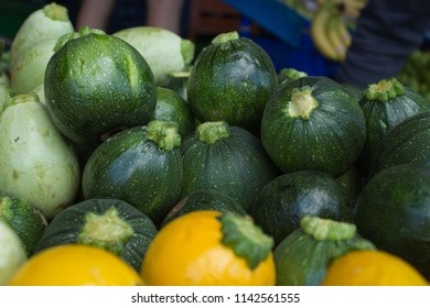 zucchini squash ball zucchini yellow green organic vegan nutrition vegetable market  summer squash organic farming courgette raw diet