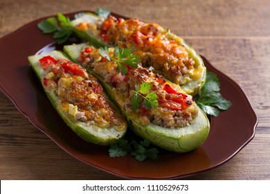 Zucchini stuffed with meat, vegetables and cheese. Zucchini boats