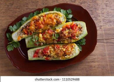 Zucchini stuffed with meat, vegetables and cheese. Zucchini boats. View from above, top studio shot