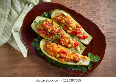 Zucchini stuffed with meat, vegetables and cheese. Zucchini boats. Loaded zucchini. overhead, horizontal