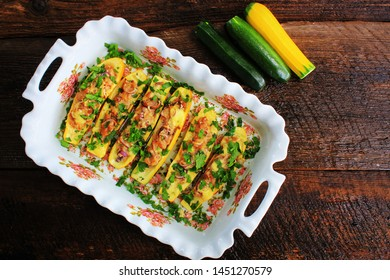 Zucchini stuffed with minced meat, cheese and mushroom. Baked in oven.