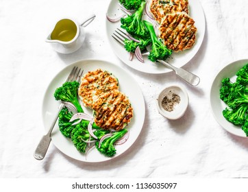 Zucchini turkey burgers and broccoli on a white background, top view. Healthy balanced food concept. Flat lay