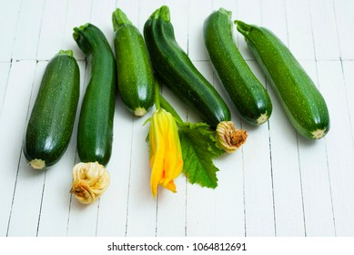 zucchini vegetables with flower on white wooden table