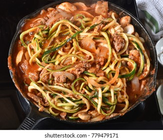 Zucchini or Zoodle spaghetti in a cast iron skillet