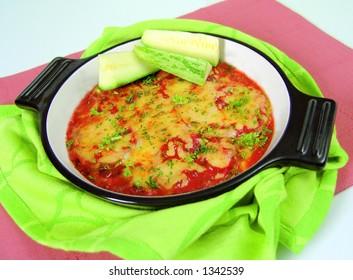 Zuccini quiche gratinated with tomato and mozzarella cheese