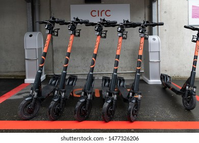 Zug, ZG / Switzerland - August 12th 2019: Circ electric scooter parked at the Trainstation in Zug on a rainy summer day.