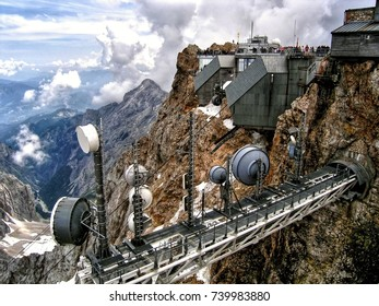 The Zugspitze at 2,962 m above sea level, is the highest peak in Germany. It lies south of the town of Garmisch-Partenkirchen, and the Austria–Germany border runs over its western summit.