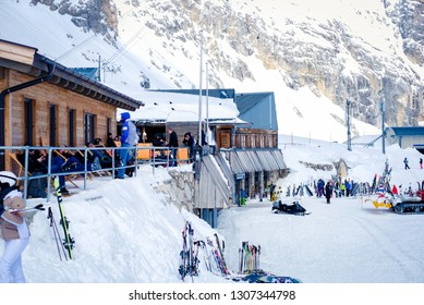 Zugspitze, Germany - April 1, 2018 : People enjoying in ski area at Zugspitze mountain. Zugspitze mountain is the highest place in Bavaria, Garmisch-Partenkirchen, Germany.