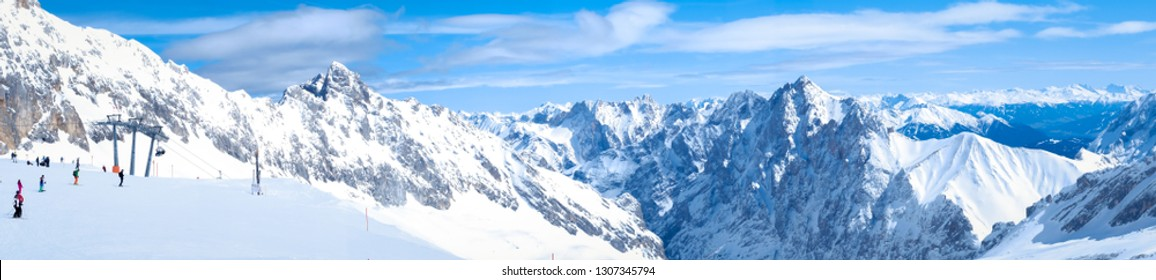 Zugspitze, Germany - April 1, 2018 : Beautiful view of Zugspitze mountain. The highest place in Bavaria, Garmisch-Partenkirchen, Germany. Snowy peaks of the Alpine Mountains.