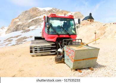 ZUGSPITZE GERMANY - JULY 5, 2016: The Pistenbully 300 W Polar snowcat ready for ski slope maintenance in Zugspitze arena. Most famous ski resort in alps on Germany Austria border.