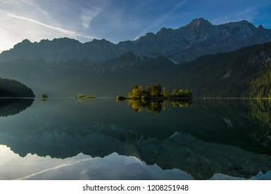 Zugspitze, the highest mountain of Germany, reflecting in Eibsee on a clear morning