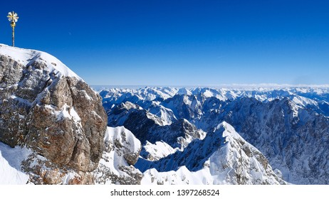 zugspitze mountain alpine beautiful scenic panorama. Panoramic snow alpen mountains at sunny winter with blue sky.  landscape with snowy peaks of the mountains. Germany landmark