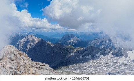 Zugspitze mountain is the highest place in Bavaria, Germany. Snowy peaks of the Alpine Mountains. View of the observation deck at the top of Zugspitze
