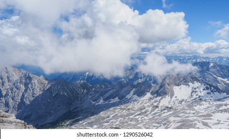 Zugspitze mountain is the highest place in Bavaria, Germany. Snowy peaks of the Alpine Mountains. View of the observation deck at the top of Zugspitze.