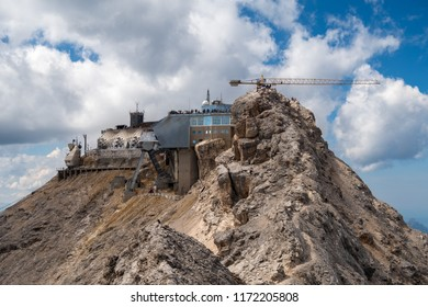 Zugspitze station, top of the mountain with clouds in background, as seen from via ferrata jubilaumsgrat, the cableway under construct, Germany/Austria