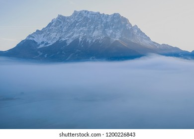 The Zugspitze at sunrise surrounded by fog