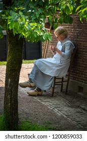 Zuiderzee museum, Enkhuizen, The Netherlands - May 9, 2019 : A woman in old fashioned village clothes in the Zuiderzee museum