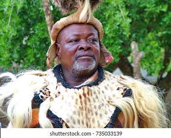 ZULULAND,  SOUTH AFRICA - CIRCA November 2011:Unidentified man dressed in Zulu warrior clothing at Shakaland Zulu Cultural Village, KwaZulu-Natal, South Africa