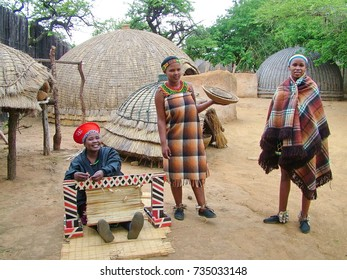 ZULULAND,  SOUTH AFRICA - CIRCA November 2011:Unidentified Zulu women in traditional Zulu clothing at Shakaland Zulu Cultural Village, KwaZulu-Natal, South Africa
