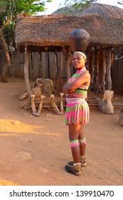 ZULULAND, SOUTH AFRICA - SEPTEMBER 14: Zulu women in traditional closes in Shakaland Zulu Village on September 14, 2009. A unique cultural center built on the set of movies Shaka Zulu and John Ross
