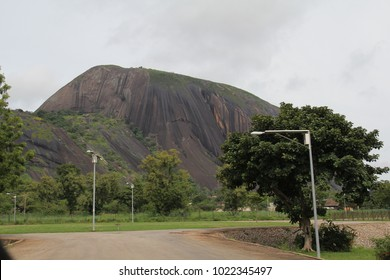 Zuma Rock, a large monolith, an igneous intrusion composed of gabbro and granodiorite, located in Niger State, Nigeria, near the capital Abuja. It's depicted on the 100 naira note.