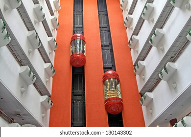 ZUNHUA COUNTY OF HEBEI PROVINCE - March 28: Modern elevator and red walls in a traders Hotel on March 28, 2012, Zunhua County, Hebei Province, China.